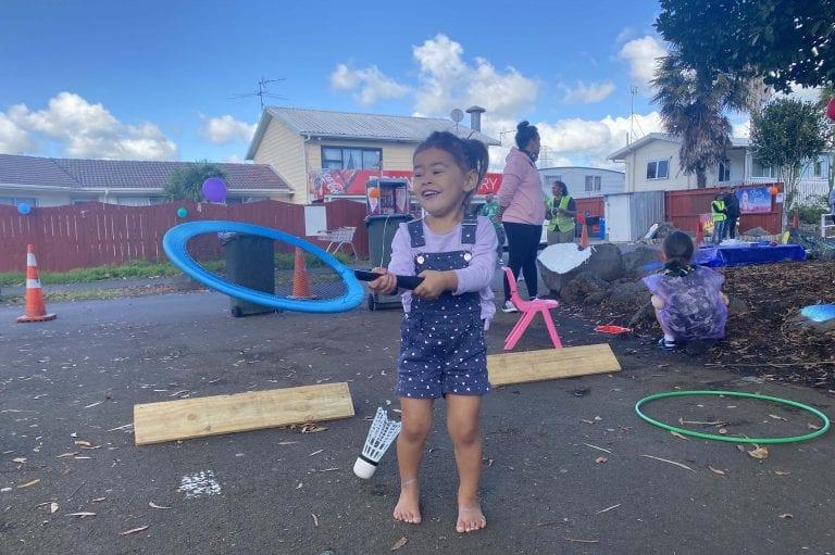 Children enjoying playing on their street in Takaanini.